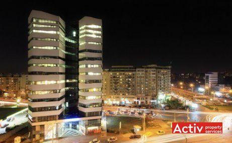 Clădirea de birouri Olympia Tower, domină peisajul Pieței Muncii - vedere nocturnă cu perspectivă asupra intersecției bulevardelor Mihai Bravu, Decebal și Calea Călărași.